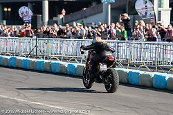Stunt artist and racer Mai Lin Senf at the 1/8 mile sprint races during the Intermot International Motorcycle Fair. Cologne, Germany. Saturday October 6, 2018. Photography ©2018 Michael Lichter.