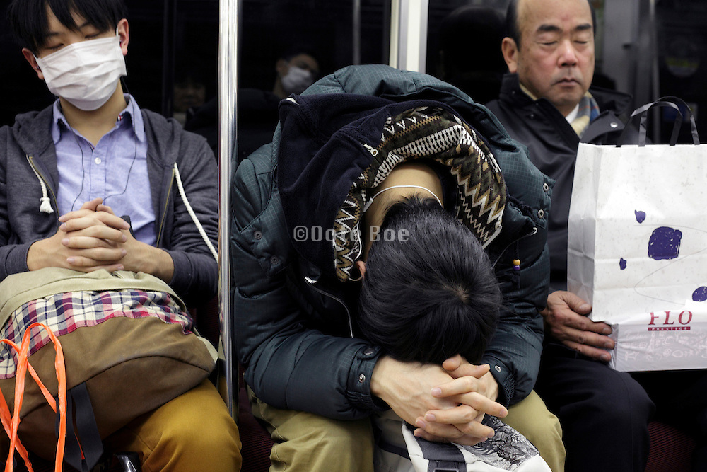 Japan Tokyo people during a commuting nap