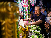 30 MARCH 2018 - BANGKOK, THAILAND: Thai Catholics pray as they pass Jesus body after his crucifixion during Good Friday observances at Santa Cruz Church in the Thonburi section of Bangkok. Santa Cruz Church is more than 350 years old and is one of the oldest Catholic churches in Thailand. Good Friday is the day that most Christians observe as the crucifixion of Jesus Christ. Thailand has a small Catholic community.     PHOTO BY JACK KURTZ