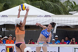 May 5, 2018 - Pasay, National Capital Region, Philippines - The first day of FIVB (Fédération Internationale de Volleyball) Beach Volleyball World Tour, Manila Open 2018, with its third day for women's quarter finals. Games are held on Sands SM by the Bay area of SM Mall of Asia...Its Philippines versus Japan for the quarter finals. Philippines team in blue top are (1) Cherry Ann Rondina and (2) Angeline Marie Gervacio. Japan team in orange top are (1) Shinako Tanaka and (2) Sakurako Fuji...Angeline Marie Gervacio gives a powerful strike as it goes through a block by Shinako Tanaka. (Credit Image: © George Buid via ZUMA Wire)