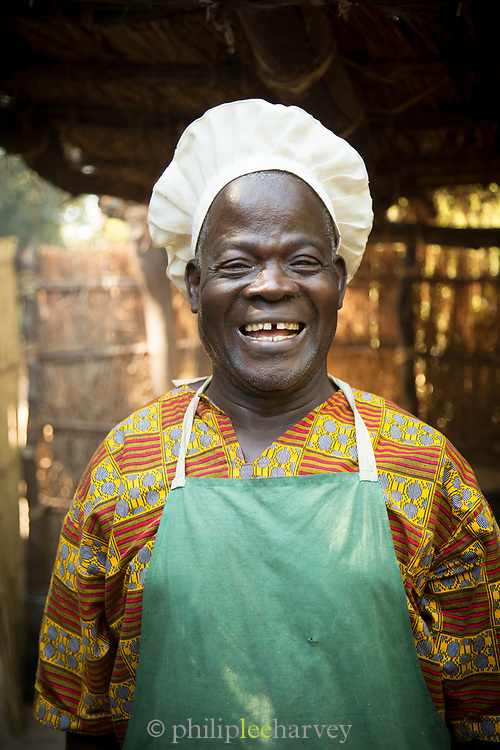 Chef wearing apron and chefs hat at Chikoko Tree Camp, South Luangwa National Park, Zambia
