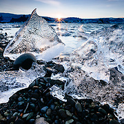 Sunset highlights the unique shape, texture, and colors of the icebergs found on the shores of the Jökulsárlón Lagoon in Skaftafell National Park.