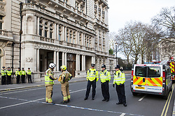 London, UK. 9th March, 2019. An Incident Commander and Monitoring Officer from London Fire Brigade and the Metropolitan Police respond to a security alert involving a 'suspicious car' close to New Scotland Yard in Westminster.