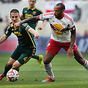 Will Johnson, (left), Portland Timbers, is challenged by Thierry Henry, New York Red Bulls, in action during the New York Red Bulls Vs Portland Timbers, Major League Soccer regular season match at Red Bull Arena, Harrison, New Jersey. USA. 24th May 2014. Photo Tim Clayton