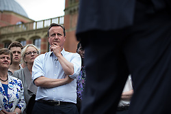 © Licensed to London News Pictures . 22/06/2016 . Birmingham , UK . DAVID CAMERON listens to GORDON BROWN (pictured in silhouette , r) speak . British Conservative Party Prime Minister David Cameron , Tim Farron and Paddy Ashdown from the Liberal Democrat Party and Harriet Harman from the Labour Party , attend a joint rally at Birmingham University in support of the REMAIN in EU campaign , ahead of referendum polling opening tomorrow morning (23rd June 2016) . Photo credit: Joel Goodman/LNP
