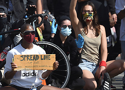 Halsey takes cover from tear gas and rubber bullets with at protest turned riot with Yungblud at a police brutality protest in Santa Monica, Calif. on Sunday. Halsey and Yungblud sat on the front line of the protest in the middle of the street where they took incoming tear gas and rubber bullets because they refused to leave. Cops warned them for two hours to leave the unlawful gathering of hundreds of angry demonstrators and rioters. After the tear gas, Halsey and Yungblud decide to leave. Peaceful protesters stayed at Palisades Park but other protesters got separated and caught up in a violent riot where many rioters through stones, bricks, M-80 explosives at the police and the police responded with tear gas and rubber bullets. The demonstrators tried to take over the Santa Monica Pier but were stopped by the police. Then there was a stand off which Halsey was a part of. 31 May 2020 Pictured: Halsey takes cover from tear gas and rubber bullets with at protest turned riot with Yungblud. Photo credit: GAC / MEGA TheMegaAgency.com +1 888 505 6342