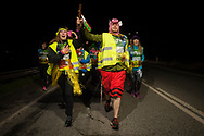 """Disguised people run on the 20th Korrika. Castejon (Basque Country). April 1, 2017. The """"Korrika"""" is a relay course, with a wooden baton that passes from hand to hand without interruption, organised every two years in a bid to promote the basque language. The Korrika runs over 11 days and 10 nights, crossing many Basque villages and cities. This year was the 20th edition and run more than 2500 Kilometres. Some people consider it an honour to carry the baton with the symbol of the Basques, """"buying"""" kilometres to support Basque language teaching. (Gari Garaialde / Bostok Photo)"""
