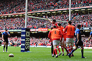 Alex Cuthbert of Wales © celebrates with the Welsh replacements after he scores the opening try. RBS Six nations champs 2012, Wales v France at the Millennium Stadium in Cardiff, South Wales on Saturday 17th March 2012.  pic by Andrew Orchard, Andrew Orchard sports photography,