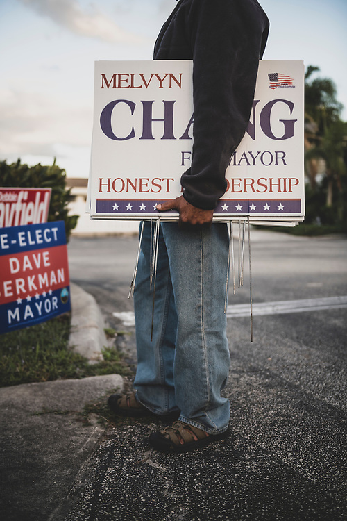 """Melvyn Chang pulls up his campaign signs outside Eastminster Presbyterian Church, a voting precinct in Indialantic, Florida, on November 3, 2020. Chang lost the mayorial election but said it was great to see  """"so many people engaged in the American democratic process."""""""
