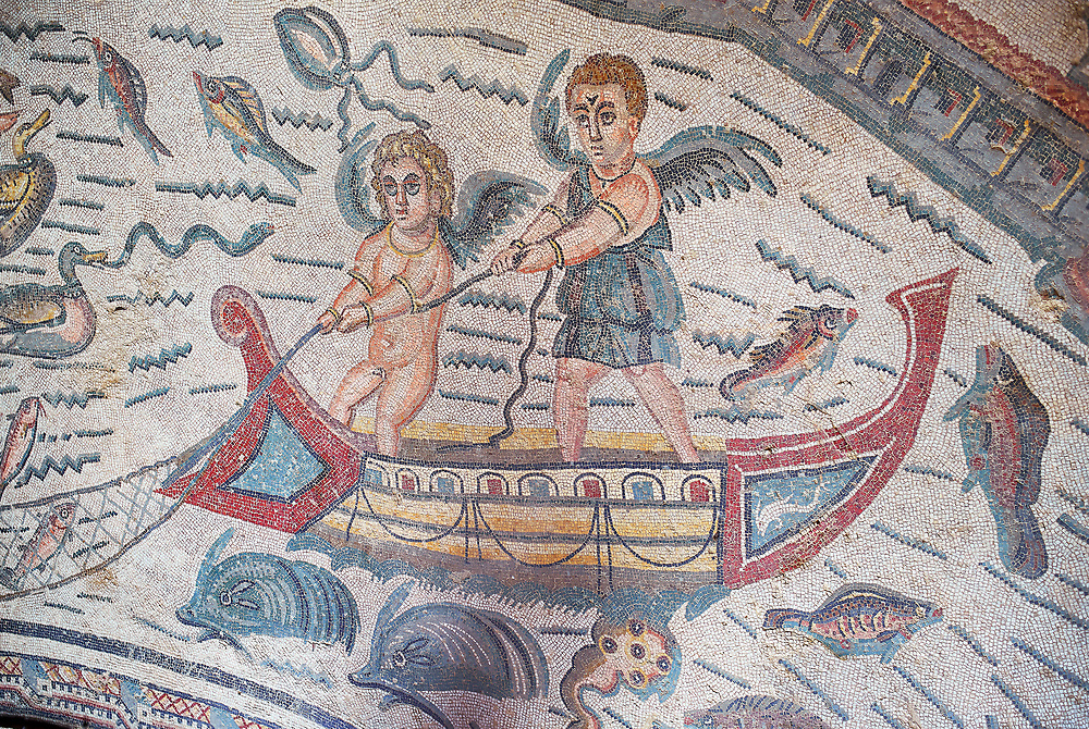 Close up detail picture of the Roman mosaics of the Semi Circular Room, depicting cupids fishing from boats, at the Villa Romana del Casale, first quarter of the 4th century AD. Sicily, Italy. A UNESCO World Heritage Site. .<br /> <br /> If you prefer to buy from our ALAMY PHOTO LIBRARY  Collection visit : https://www.alamy.com/portfolio/paul-williams-funkystock/villaromanadelcasale.html<br /> Visit our ROMAN MOSAICS PHOTO COLLECTIONS for more photos to buy as buy as wall art prints https://funkystock.photoshelter.com/gallery/Roman-Mosaics-Roman-Mosaic-Pictures-Photos-and-Images-Fotos/G00008dLtP71H_yc/C0000q_tZnliJD08
