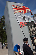 A week after a Black Lives Matter protest turned to violence when the statue of wartime Prime Minister Sir Winston Churchill was daubed in graffiti which called him a racist, and despite warning from police not to attend protests at all today - and to be off the streets by 5.00pm - a large group crowd of right-wing groups and veterans gathered at the boxed-in statue to protect it from further vandalism by Black Lives Matter and anti-racism protesters, on 13th June 2020, in London, England.