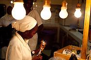 Senegal, May 2009. Centre de Sante de Mbour. A nurse prepares to give an injection to a patient.