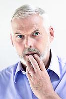 caucasian senior man portrait stun pensive isolated studio on white background