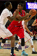 DALLAS, TX - JANUARY 4: Markus Kennedy #5 of the SMU Mustangs brings the ball up court against the Connecticut Huskies on January 4, 2014 at Moody Coliseum in Dallas, Texas.  (Photo by Cooper Neill) *** Local Caption *** Markus Kennedy