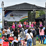 Ivan Antalika is a singer with his wife at the 10th-year-anniversary celebration Mauritius Open Air Festival (MOAF2019) biggest and non-stop performs with food from all over the globe and craft at Trent Park, on 14 July 2019, London, UK.