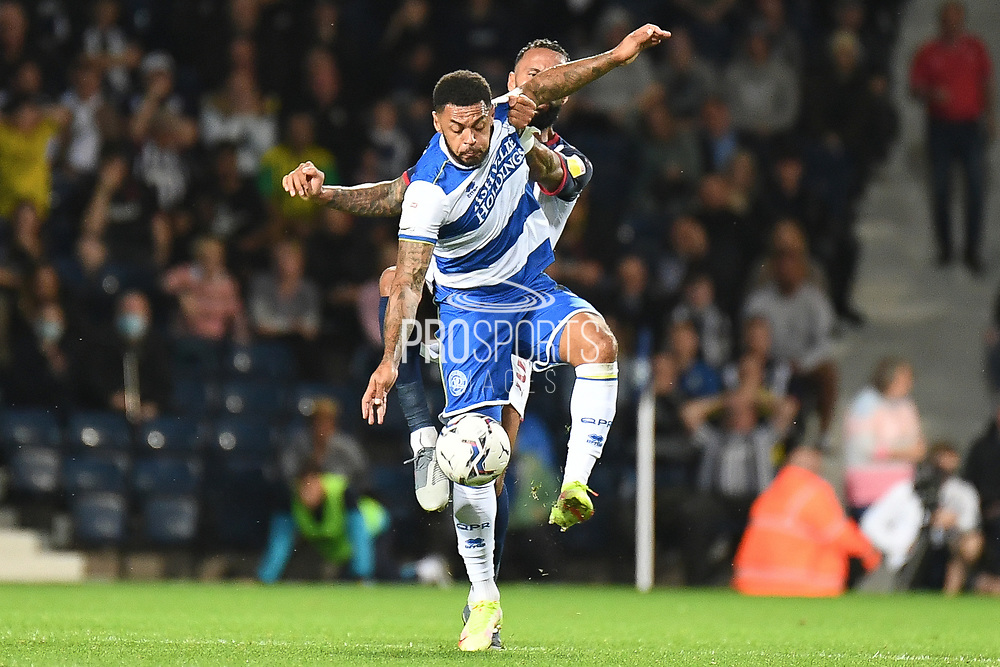QPR forward (on loan from Watford) Andre Gray (19) battles for possession  with West Bromwich Albion defender Kyle Bartley (5) during the EFL Sky Bet Championship match between West Bromwich Albion and Queens Park Rangers at The Hawthorns, West Bromwich, England on 24 September 2021.