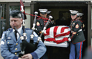 Marines bring the casket from inside the church after the funeral service.  Funeral for Lance Cpl. Michael L. Ford a New Bedford marine that was killed in Iraq when the tank he was operating ran over an explosive device.  The funeral service was held at Church of Jesus Christ of Latter Day Saints in North Dartmouth, MASS and the burial was then held at the National Cemetary in Onset, MASS.