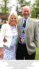 MR CHRIS WRIGHT chairman of the Chrysalis Group and MISS JANICE STINNES, at a race meeting in Surrey on 25th April 2003.PJD 30