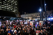 """SAN FRANCISCO, CA - DECEMBER 17: Several hundred protesters look on during demonstrations in part of a national impeachment rally, at the San Francisco Federal Building in San Francisco, California on December 17, 2019. Protesters around the nation participated in """"Nobody is Above the Law"""" rallies on the eve of a historic Trump impeachment vote in the United States House of Representatives. (Photo by Philip Pacheco/AFP)"""