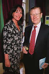 MR & MRS ERIC MORLEY organisers of Miss World,  at a party in London on 25th May 1999.MSL 27