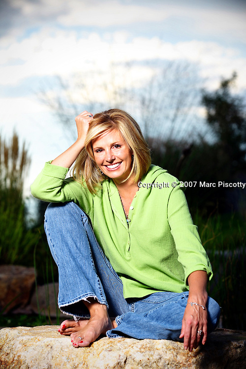 """SHOT 8/26/2007 - Julie Aigner-Clark, the founder of Baby Einstein and The Safe Side, relaxes in and around her Centennial, Co. home where she has lived with her family for the past five years. She was photographed with her husband, Bill, and two daughters Aspen, 13, and Sierra, 10 as well as """"Eliot"""", one of the family's cats. Aigner-Clark went on to sell the Baby Einstein Company to Disney, after which they bought the house they now live in which was owned by former Denver Broncos' running back Terrell Davis. Aigner-Clark is now part of the The Safe Side, a company dedicated to making the world safer for children through publishing programs for kids and parents and donating a portion of any proceeds to The National Center For Missing & Exploited Children.  (Photo by Marc Piscotty © 2007)"""