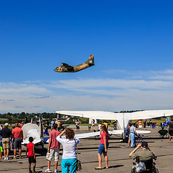 Lancaster, PA, USA - August 22, 2015: C-123 Provider Thunder-Pig from Vietnam era of flight does a fly-over at the Lancaster Airport Community Days air show.