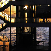 Cyclist emerges from elevator at Vancouver Convention Center in Vancouver, British Columbia.<br />  Leica M 240 / Summilux 35 mm