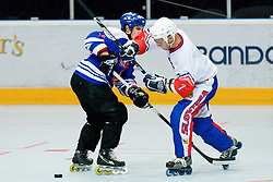 Domen Vedlin of Slovenia vs Petri Partanen of Finland at IIHF In-Line Hockey World Championships Top Division match for 5th place between National teams of Slovenia and Finland on July 3, 2010, in Karlstad, Sweden. (Photo by Matic Klansek Velej / Sportida)
