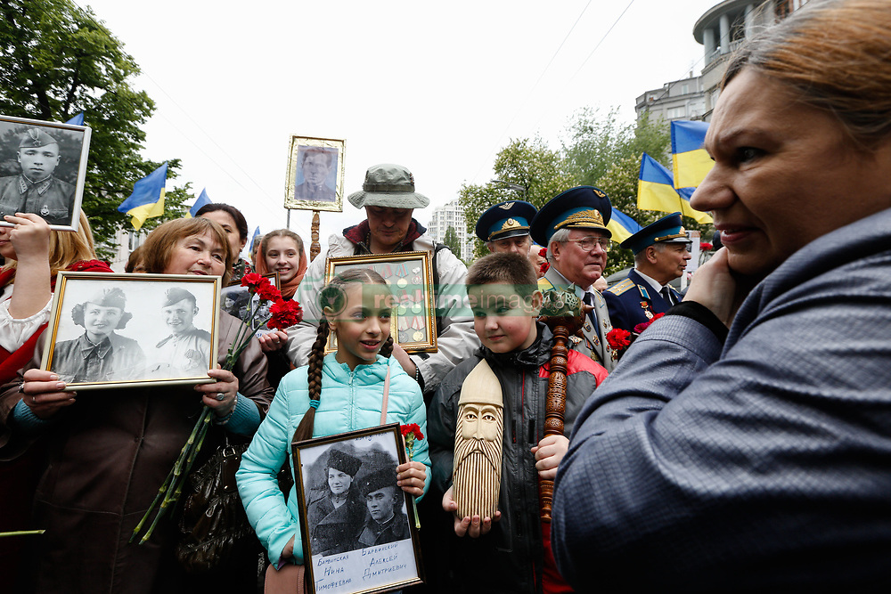 May 9, 2017 - Kiev, Ukraine - People holds the portraits of those who were killed during the WWII to participate ''The Immortal Regiment'' march in Kyiv. Ukraine commemorates the 72nd anniversary of the victory in the war of Soviet Union over the Nazis Germany, May 9, 2017. (Credit Image: © Sergii Kharchenko/NurPhoto via ZUMA Press)