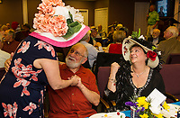 Joanne Morin with Abe and Lynn Dadian wearing their festive hats during the Unitarian Universalist Society of Laconia's Kentucky Derby party on Saturday evening at the Beane Center.  (Karen Bobotas/for the Laconia Daily Sun)