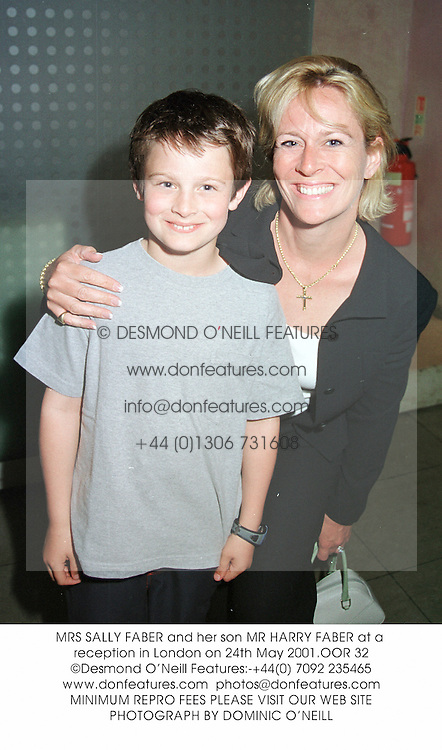 MRS SALLY FABER and her son MR HARRY FABER at a reception in London on 24th May 2001.	OOR 32