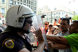 June 26, 2017 - Athens, Greece - Striking municipal workers scuffle with riot police who are guarding the entrance of the Interior Ministry during a protest, in Athens. With a heat wave expected later this week, Greece's government Monday urging striking garbage collectors to return to work after a 10-day protest has left huge piles of trash around Athens. (Credit Image: © Eurokinissi via ZUMA Wire)