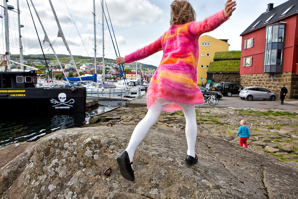 Torshavn Harbor, Streymoy Island, Faroe Islands.<br />  <br /> Children play on the harbor rocks on the weekend as Sea Shepherd's presence is felt throughout the islands.  The Colombus, a volunteer Sea Shepherd sailing boat docks in the harbor.  The Columbus is where the press conference announcing Operation Grindstop 2014 was held.