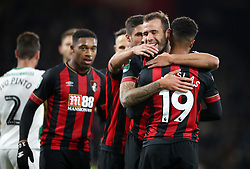 Bournemouth's Junior Stanislas (right) celebrates scoring his side's first goal of the game during the Carabao Cup, Fourth Round match at the Vitality Stadium, Bournemouth.