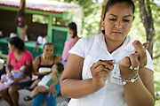 A health worker prepares to vaccinate a child during a vaccination session at the primary school in the town of Coyolito, Honduras on Wednesday April 24, 2013.