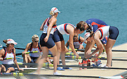 Lucerne SWITZERLAND, GBR W8+ Grab the drinks from the pontoon after the race.  Bow Jo COOK, Alison KNOWLES, Jess EDDIE, Victoria THORNLEY,Nastasha PAGE, Louisa REEVE, Katie SOLESBURY, Lindsey MAGUIRE and co Caroline O'CONNER, morning heat at the 2011 FISA World Cup on the Lake Rotsee. Friday   08/07/2011   [Mandatory Credit Peter Spurrier/ Intersport Images]