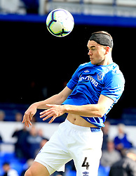 """Everton's Michael Keane in action during the Premier League match at Goodison Park, Liverpool. PRESS ASSOCIATION Photo. Picture date: Saturday September 29, 2018. See PA story SOCCER Everton. Photo credit should read: Peter Byrne/PA Wire. RESTRICTIONS: EDITORIAL USE ONLY No use with unauthorised audio, video, data, fixture lists, club/league logos or """"live"""" services. Online in-match use limited to 120 images, no video emulation. No use in betting, games or single club/league/player publications."""
