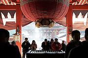 worshippers at the Asakusa Kannon Temple Tokyo