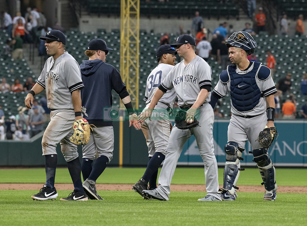 May 23, 2019 - Baltimore, Maryland, U.S. - New York Yankees players celebrate their team's victory over the Baltimore Orioles at Oriole Park at Camden Yards in Baltimore, MD on Thursday, May 23, 2019.  The Yankees won the game 6 - 5  (Credit Image: © Ron Sachs/CNP via ZUMA Wire)