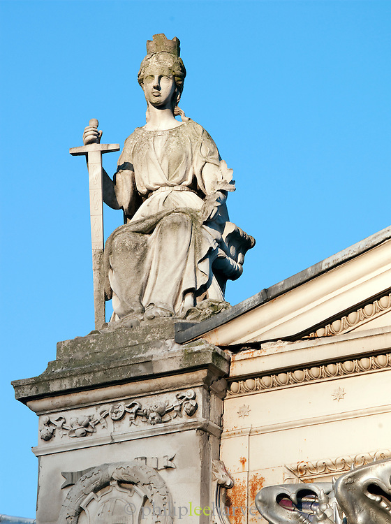 A statue on top of St Pauls Cathedral in London, UK