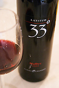 In the Sheraton Hotel Restaurant Bottle and glass of Latitud 33 thirty three degrees Malbec 2004 Mendoza, Argentina, South America