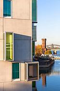 the hotel Artotel at the Rheinau harbor, in the background the Malakoff tower, Cologne, Germany.<br /> <br /> das Hotel Artotel im Rheinauhafen, im Hintergrund der Malakoffturm, Koeln, Deutschland.