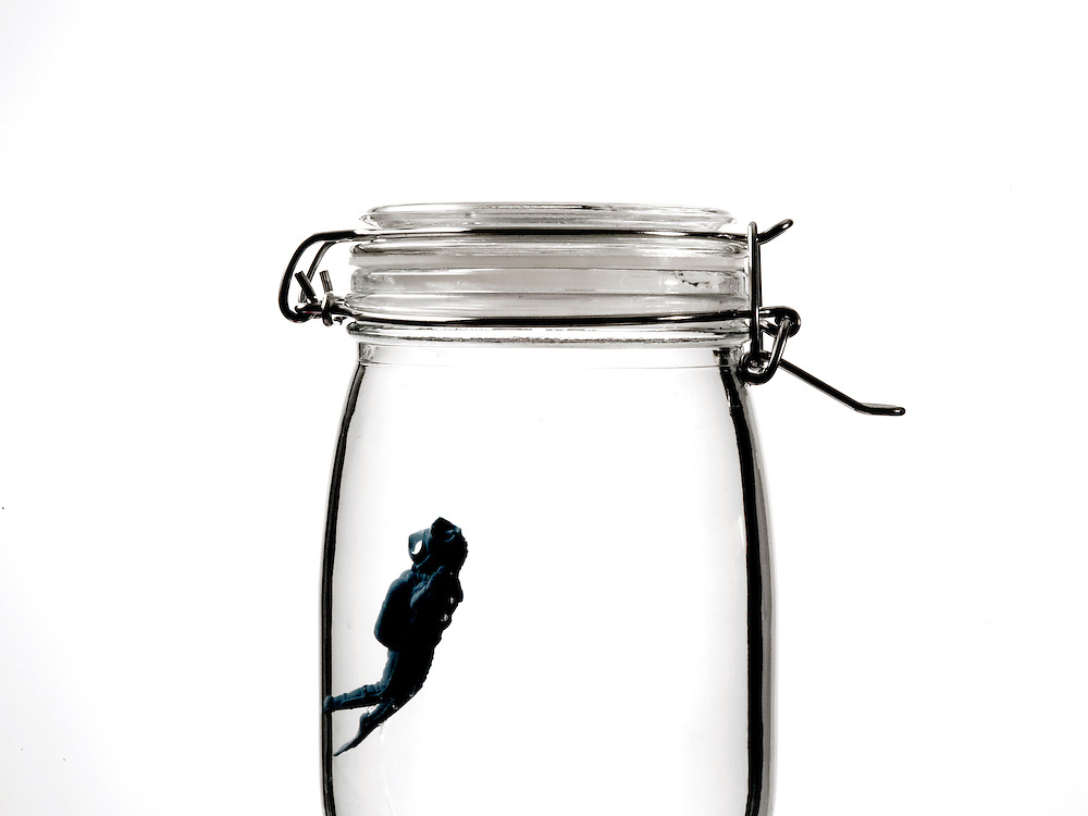 Still life Conceptual Image of a Diver trying to escape from a Jar