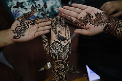 May 13, 2019 - Dhaka, Bangladesh - Women show their hand, decorated with henna During a Mehendi Festival in Dhaka. Henna, which is believed to have been used as a cosmetic for over 5000 years in Egypt and Middle Eastern countries, is a popular form of fashion among women, especially during the Eid Festival. (Credit Image: © MD Mehedi Hasan/ZUMA Wire)