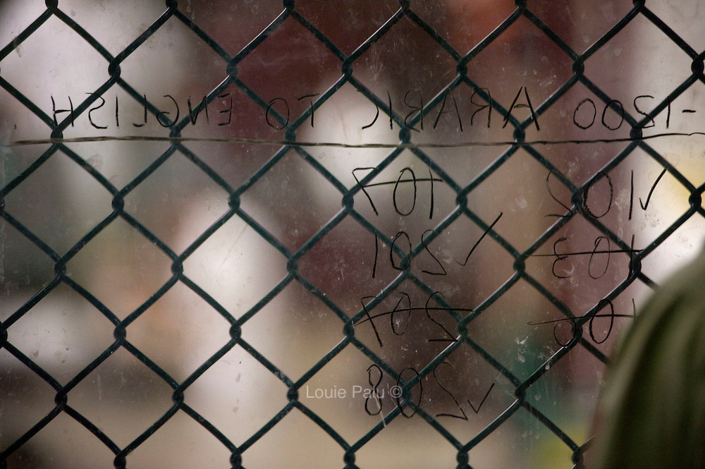 Detainees cell numbers are listed on plexiglass to sign up for Arabic to English classes available to detainees in Camp 6. The Guantanamo Bay Naval Station is where detainees related to the attacks of Sept 11, 2001 and the ensuing invasion of Afghanistan are held as alleged members or associates of al Qaeda and the Taliban, which is located at the Guantanamo Bay detention facility in Cuba which currently has less than 170 detainees. (Credit Image: © Louie Palu/ZUMA Press)...
