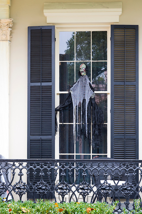Scary Halloween voodoo skeleton ghost character at mansion house in the Garden District of New Orleans, Louisiana, USA