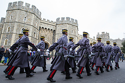 Windsor, UK. 21st February, 2019. 36 Engineer Regiment Queen's Gurkha Engineers, accompanied by the Band of the Brigade of Gurkhas, take part in the Changing of the Guard ceremony at Windsor Castle. The Queen's Gurkha Engineers will provide the Windsor Guard until April 12th, for the first time since the celebrations marking 200 years of service to the Crown in 2015. Each Gurkha carries a kukri.