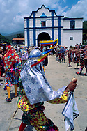 Los diablos bailan frente a la iglesia en tres filas la coreografía en honor al santísimo.  Chuao, 07-01-2001 (Ramón Lepage / Orinoquiaphoto)  The day of Corpus Christie is celebrated by the dancing devils of Chuao.  The dance represents the death of the devil on the ´´cross of forgiveness´´ and is traditionally organized by the members of church and the people of Chuao.  The sounds of drums, cuatro and maracas along with hand tailored customs and masks make for a colorful folkloric manifestation...