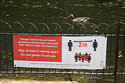 Social distancing advice banner in St James Park as lockdown continues and people observe the stay at home message in the capital on 11th May 2020 in London, England, United Kingdom. Coronavirus or Covid-19 is a new respiratory illness that has not previously been seen in humans. While much or Europe has been placed into lockdown, the UK government has now announced a slight relaxation of the stringent rules as part of their long term strategy, and in particular social distancing.