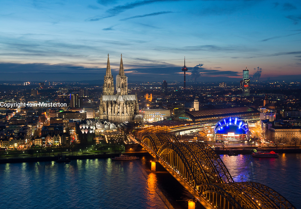 Evening view of skyline of Cologne, Germany  with floodlit Cathedral prominent